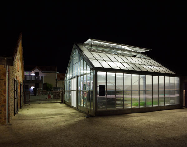 Greenhouse lit on a dark evening